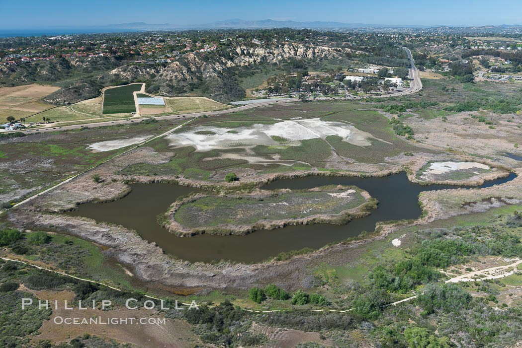 Aerial Photo of San Elijo Lagoon. San Elijo Lagoon Ecological Reserve is one of the largest remaining coastal wetlands in San Diego County, California, on the border of Encinitas, Solana Beach and Rancho Santa Fe. USA, natural history stock photograph, photo id 30587