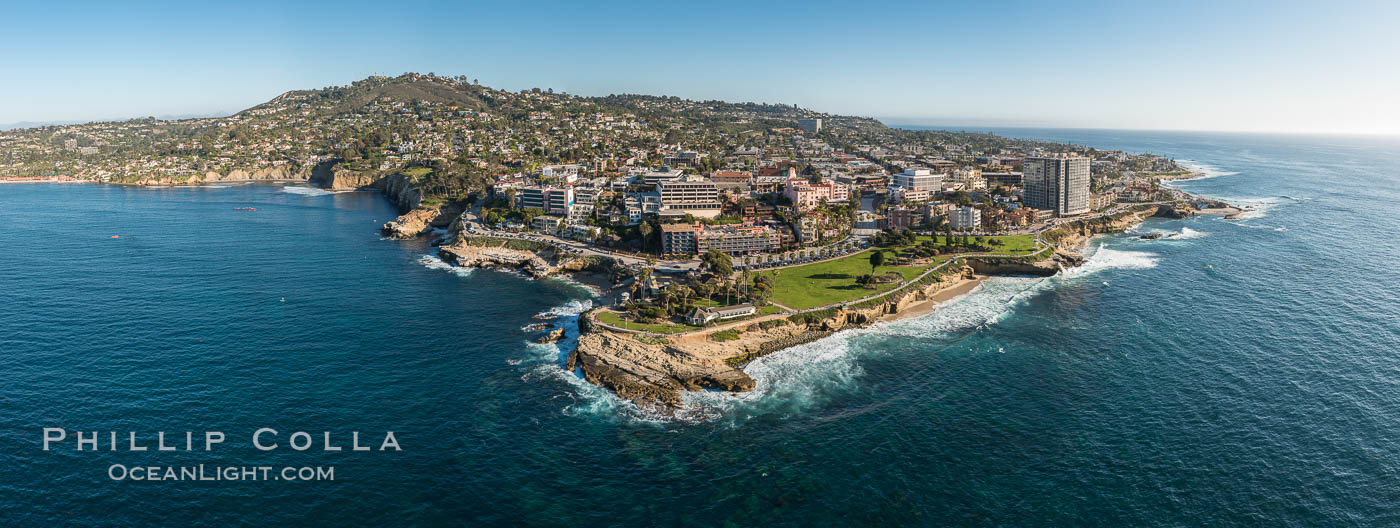 Aerial Panoramic Photo of Point La Jolla and La Jolla Cove, Boomer Beach, Scripps Park. Panoramic aerial photograph of La Jolla Cove and Scripps Parks (center), with La Jolla's Mount Soledad rising above, La Jolla Shores and La Jolla Caves to the left and the La Jolla Coast with Children's Pool (Casa Cove) to the right. The undersea reefs of Boomer Beach are seen through the clear, calm ocean waters. This extremely high resolution panorama will print 50″ high by 130″ long with no interpolation. California, USA, natural history stock photograph, photo id 30773