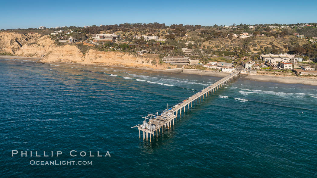 Aerial Photo of Scripps Pier. SIO Pier. The Scripps Institution of Oceanography research pier is 1090 feet long and was built of reinforced concrete in 1988, replacing the original wooden pier built in 1915. The Scripps Pier is home to a variety of sensing equipment above and below water that collects various oceanographic data. The Scripps research diving facility is located at the foot of the pier. Fresh seawater is pumped from the pier to the many tanks and facilities of SIO, including the Birch Aquarium. The Scripps Pier is named in honor of Ellen Browning Scripps, the most significant donor and benefactor of the Institution., natural history stock photograph, photo id 30738