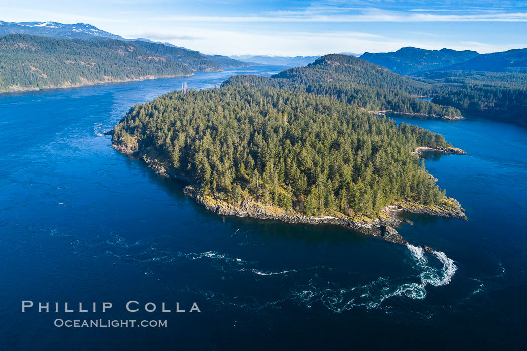 Image 34492, Seymour Narrows with strong tidal currents.  Between Vancouver Island and Quadra Island, Seymour Narrows is about 750 meters wide and has currents reaching 15 knots.  Aerial photo. British Columbia, Canada, Phillip Colla, all rights reserved worldwide. Keywords: aerial, aerial photo, british columbia, canada, current, quadra island, seymour narrows, tidal current, tide, vancouver island.