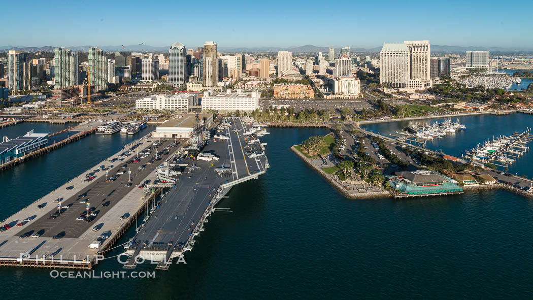 Downtown San Diego and USS Midway. The USS Midway was a US Navy aircraft carrier, launched in 1945 and active through the Vietnam War and Operation Desert Storm, as of 2008 a museum along the downtown waterfront in San Diego, natural history stock photograph, photo id 30764