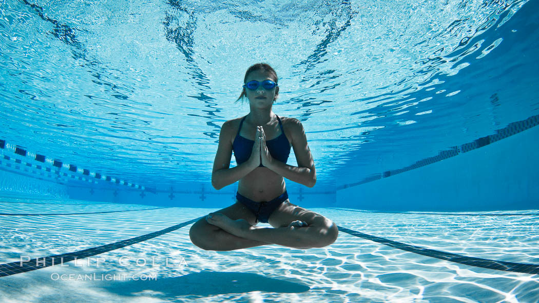 Athletic young girl underwater, performing isometric exercises., natural history stock photograph, photo id 27057