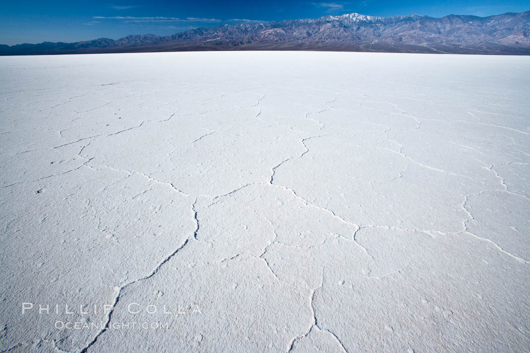 Badwater, California.  Badwater, at 282 feet below sea level, is the lowest point in North America.  9000 square miles of watershed drain into the Badwater basin, to dry and form huge white salt flats. Badwater, Death Valley National Park, California, USA, natural history stock photograph, photo id 15579