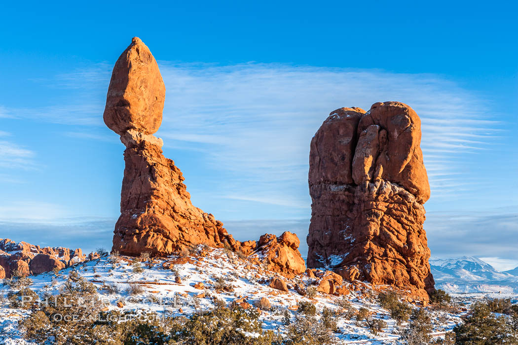 Balanced Rock, a narrow sandstone tower, appears poised to topple.  Sunset, winter. Balanced Rock, Arches National Park, Utah, USA, natural history stock photograph, photo id 18157