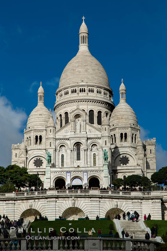 Sacre-Coeur Basilica.  The Basilica of the Sacred Heart of Paris, commonly known as Sacre-Coeur Basilica, is a Roman Catholic church and minor basilica, dedicated to the Sacred Heart of Jesus, in Paris, France. A popular landmark, the basilica is located at the summit of the butte Montmartre, the highest point in the city. Basilique du Sacre-Coeur, natural history stock photograph, photo id 28153