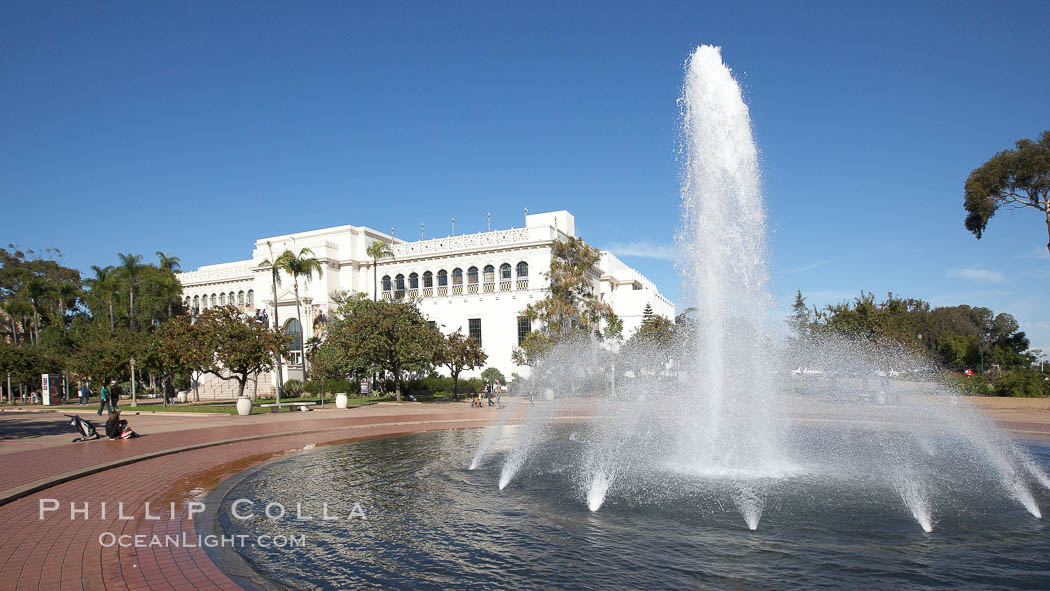 The Bea Evenson Fountain is the centerpiece of the Plaza de Balboa in Balboa Park, San Diego.  The San Diego Natural History Museum is seen in the background. Balboa Park, San Diego, California, USA, natural history stock photograph, photo id 22177