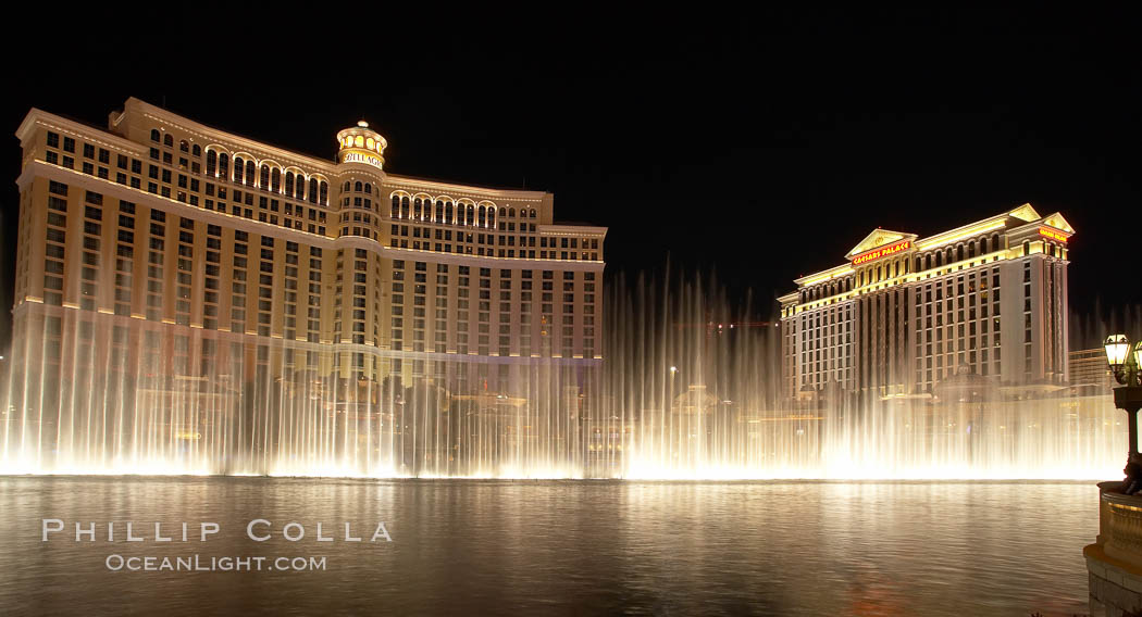 The Bellagio Hotel (left) and Caesar's Palace (right), seen behind the Bellagio fountains, at night.  The Bellagio Hotel fountains are one of the most popular attractions in Las Vegas, showing every half hour or so throughout the day, choreographed to famous Hollywood music. Nevada, USA, natural history stock photograph, photo id 20576