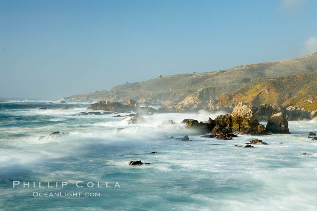 Waves blur as they break over the rocky shoreline of Big Sur. California, USA, natural history stock photograph, photo id 14906