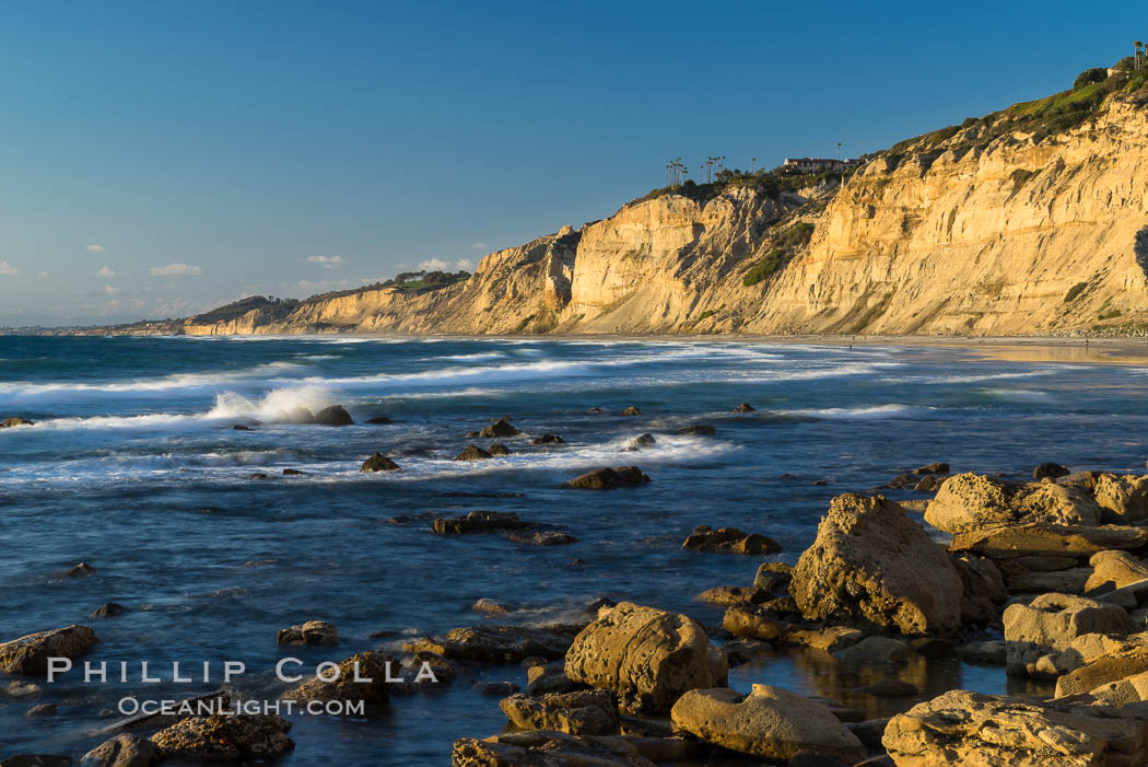 Black's Beach sea cliffs, sunset, looking north from Scripps Pier with Torrey Pines State Reserve in the distance. La Jolla, California, USA, natural history stock photograph, photo id 29170