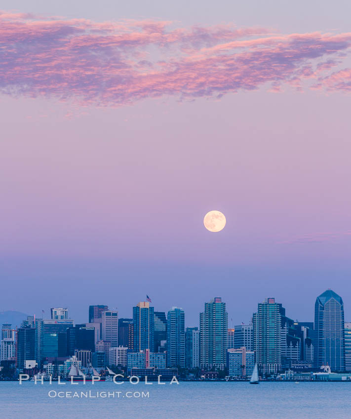 "Blue Moon at Sunset over San Diego City Skyline.  The third full moon in a season, this rare ""blue moon"" rises over San Diego just after sundown. San Diego, California, USA, natural history stock photograph, photo id 28755"