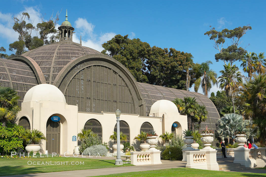 The Botanical Building in Balboa Park, San Diego.  The Botanical Building, at 250 feet long by 75 feet wide and 60 feet tall, was the largest wood lath structure in the world when it was built in 1915 for the Panama-California Exposition. The Botanical Building, located on the Prado, west of the Museum of Art, contains about 2,100 permanent tropical plants along with changing seasonal flowers. The Lily Pond, just south of the Botanical Building, is an eloquent example of the use of reflecting pools to enhance architecture. The 193 by 43 foot pond and smaller companion pool were originally referred to as Las Lagunas de las Flores (The Lakes of the Flowers) and were designed as aquatic gardens. The pools contain exotic water lilies and lotus which bloom spring through fall.  Balboa Park, San Diego. Balboa Park, San Diego, California, USA, natural history stock photograph, photo id 14579