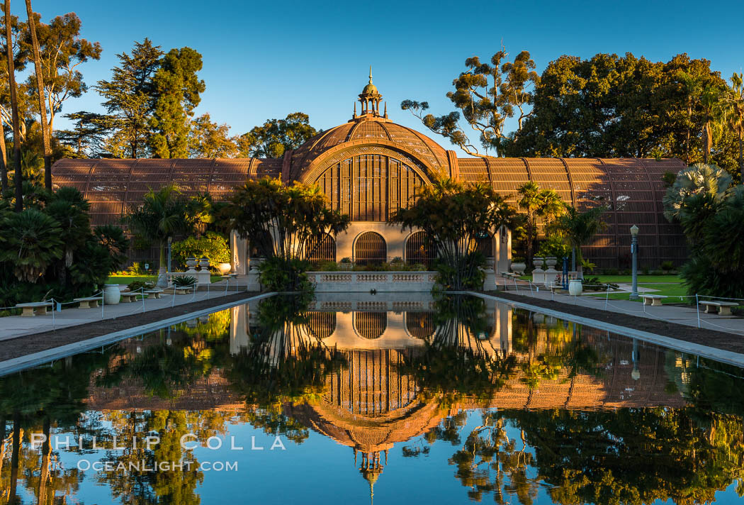 The Botanical Building in Balboa Park, San Diego. The Botanical Building, at 250 feet long by 75 feet wide and 60 feet tall, was the largest wood lath structure in the world when it was built in 1915 for the Panama-California Exposition. The Botanical Building, located on the Prado, west of the Museum of Art, contains about 2,100 permanent tropical plants along with changing seasonal flowers. The Lily Pond, just south of the Botanical Building, is an eloquent example of the use of reflecting pools to enhance architecture. The 193' by 43' foot pond and smaller companion pool were originally referred to as Las Lagunas de las Flores (The Lakes of the Flowers) and were designed as aquatic gardens. The pools contain exotic water lilies and lotus which bloom spring through fall. Balboa Park, San Diego, California, USA, natural history stock photograph, photo id 28823