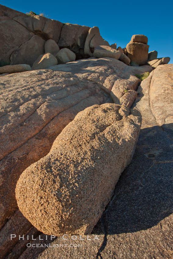 Boulders and sunset in Joshua Tree National Park.  The warm sunlight gently lights unusual boulder formations at Jumbo Rocks in Joshua Tree National Park, California. Joshua Tree National Park, California, USA, natural history stock photograph, photo id 26745