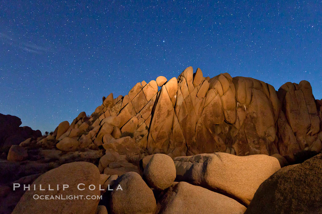 Boulders and stars, moonlight in Joshua Tree National Park. The moon gently lights unusual boulder formations at Jumbo Rocks in Joshua Tree National Park, California. USA, natural history stock photograph, photo id 27718