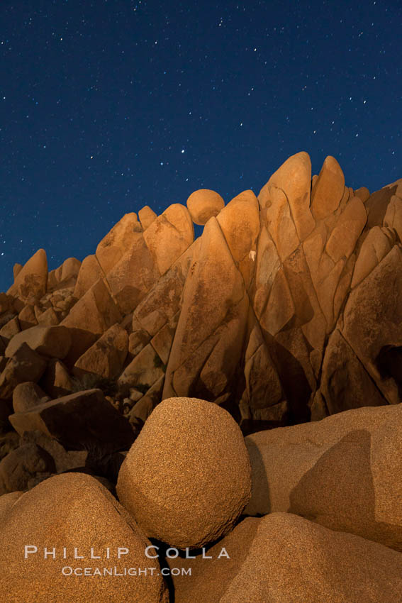 Boulders and stars, moonlight in Joshua Tree National Park. The moon gently lights unusual boulder formations at Jumbo Rocks in Joshua Tree National Park, California. Joshua Tree National Park, California, USA, natural history stock photograph, photo id 27716