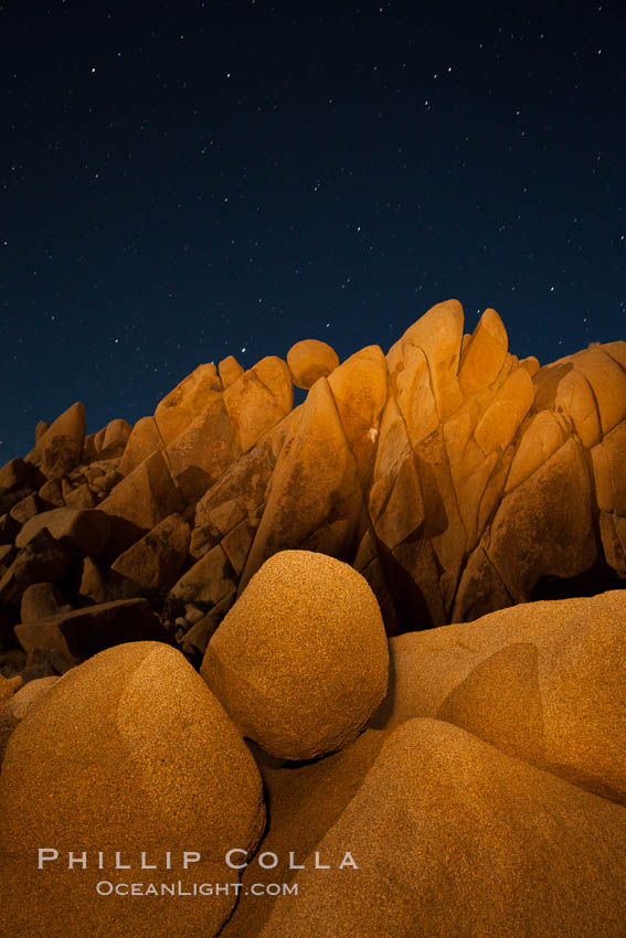 Boulders and stars, moonlight in Joshua Tree National Park. The moon gently lights unusual boulder formations at Jumbo Rocks in Joshua Tree National Park, California. Joshua Tree National Park, California, USA, natural history stock photograph, photo id 27715