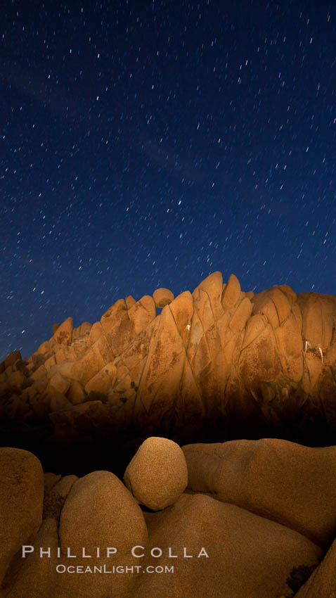 Image 27719, Boulders and stars, moonlight in Joshua Tree National Park. The moon gently lights unusual boulder formations at Jumbo Rocks in Joshua Tree National Park, California. USA, Phillip Colla, all rights reserved worldwide. Keywords: astrophotography, boulder, california, desert, dusk, evening, joshua tree, joshua tree national park, landscape, landscape astrophotography, moon light, national park, night, outdoors, outside, rock, scene, scenery, scenic, sky, southwest, star field, stars.