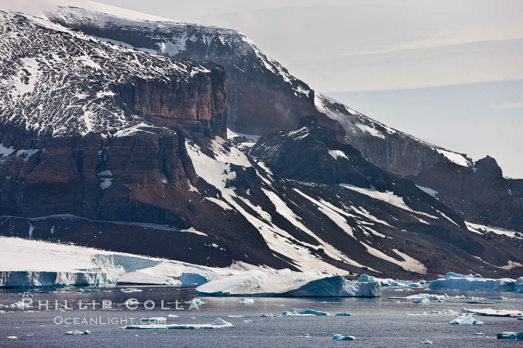 Brown Bluff, the eroded remains of an extinct volcanic structure, below which many penguins and seabirds nest. Antarctic Sound, Antarctic Peninsula, Antarctica, natural history stock photograph, photo id 24809