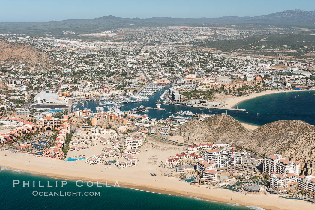 Image 28889, Cabo San Lucas, marina and downtown, showing extensive development and many resorts and sport fishing boats. Cabo San Lucas, Baja California, Mexico, Phillip Colla, all rights reserved worldwide. Keywords: abaja, aerial, aerial photograph, baja california, beach, cabo marina, cabo san lucas, coast, development, downtown, harbor, hotel, marina, mexico, ocean, real estate, resort, sea, sea of cortez, ultralight.