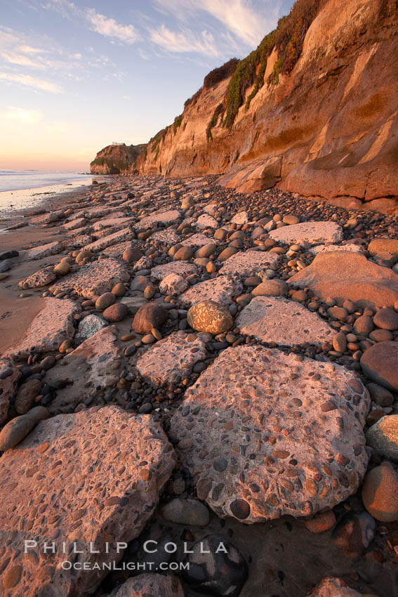 """Remains of the old historic """"Coast Highway 101"""", undermined as the bluff upon which it was built eroded away, now broken into pieces of concrete and asphalt blocks and fallen down the sea cliffs, lying on the beach. Carlsbad, California, USA, natural history stock photograph, photo id 22192"""