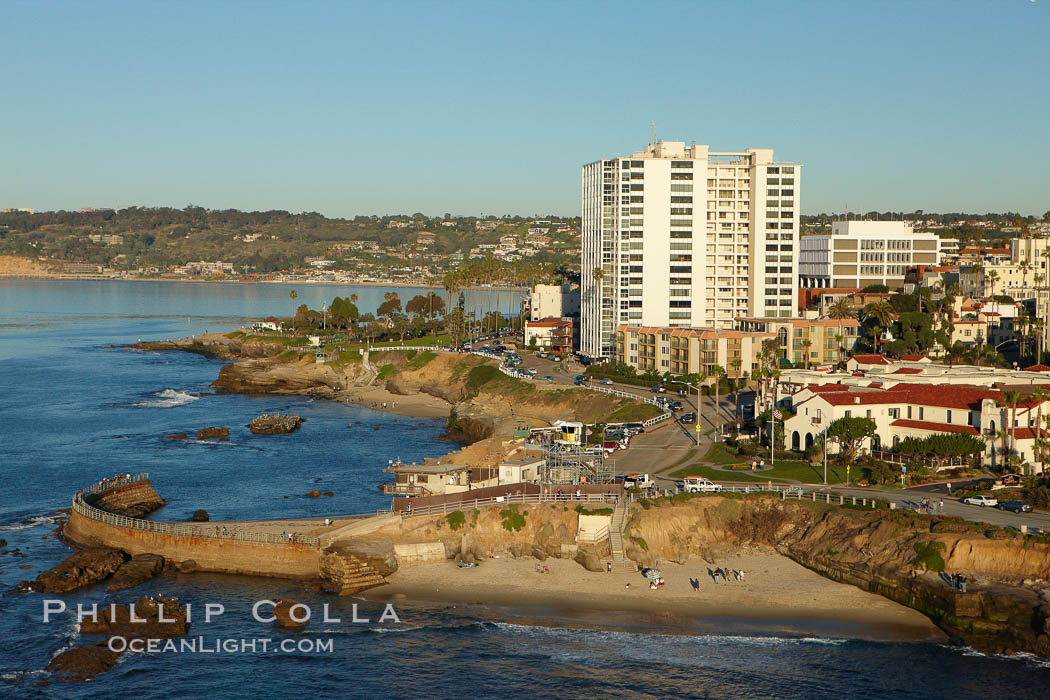 The Children's Pool in La Jolla, also known as Casa Cove, is a small pocket cove protected by a curving seawall, with the rocky coastline and cottages and homes of La Jolla seen behind it. California, USA, natural history stock photograph, photo id 22464