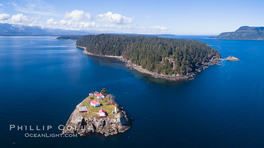Chrome Island (foreground) and Denman Island, Hornby Island in the distance. British Columbia, Canada, natural history stock photograph, photo id 34475