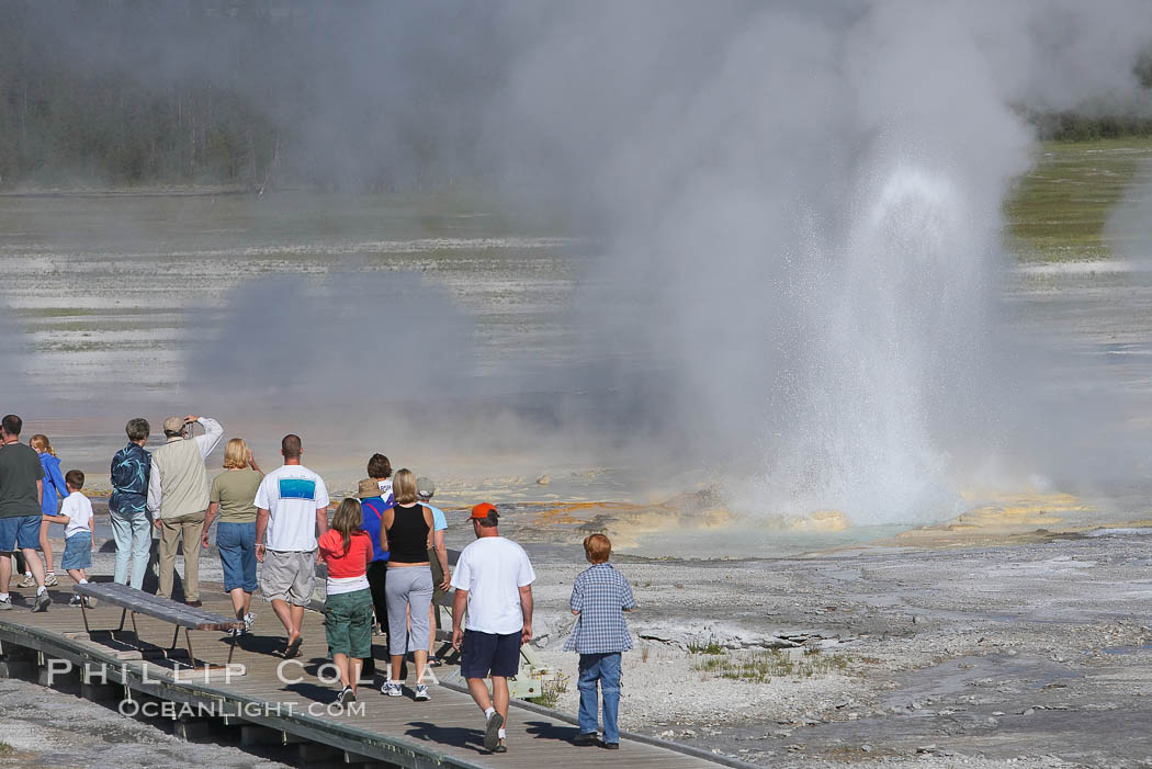 Visitors watch Clepsydra Geyser erupts almost continuously, reaching heights of  feet.  Its name is Greek for water clock, since at one time it erupted very regularly with a three minute interval.  Lower Geyser Basin. Yellowstone National Park, Wyoming, USA, natural history stock photograph, photo id 13535