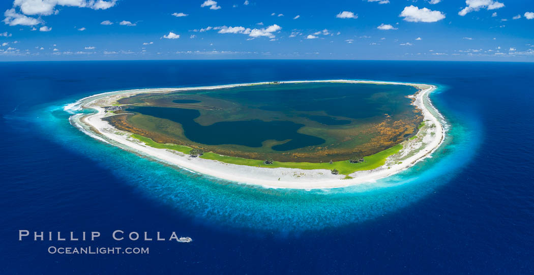 Image 32889, Aerial panorama of Clipperton Island, showing the entire atoll.  Clipperton Island, a minor territory of France also known as Ile de la Passion, is a small (2.3 sq mi) but  spectacular coral atoll in the eastern Pacific. By permit HC / 1485 / CAB (France)., Phillip Colla, all rights reserved worldwide. Keywords: aerial, aerial panorama, atoll, clipperton island, coral, france, ile de la passion, island, pacific, panorama, panoramic photo, permit hc   1485   cab, permit hc 1485 cab.