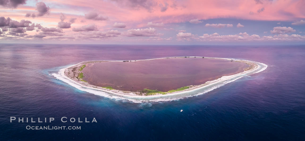 Sunset at Clipperton Island, aerial panoramic photo showing the entire atoll.  Clipperton Island, a minor territory of France also known as Ile de la Passion, is a small (2.3 sq mi) but  spectacular coral atoll in the eastern Pacific. By permit HC / 1485 / CAB (France). Clipperton Island, France, natural history stock photograph, photo id 32895