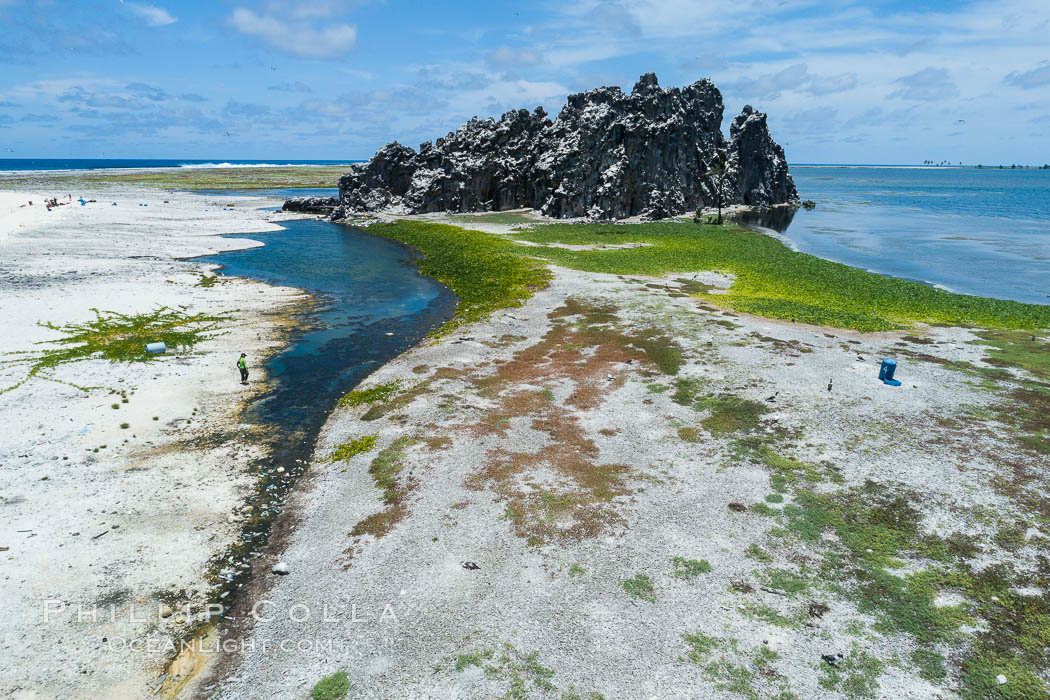 Clipperton Rock, a 95' high volcanic remnant, is the highest point on Clipperton Island, a spectacular coral atoll in the eastern Pacific. By permit HC / 1485 / CAB (France). Clipperton Island, France, natural history stock photograph, photo id 32830