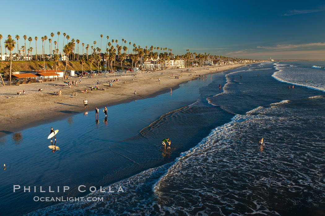 The coast of Oceanside California, waves and surfers, beach houses, just before sunset, winter, looking south. Oceanside Pier, USA, natural history stock photograph, photo id 27598