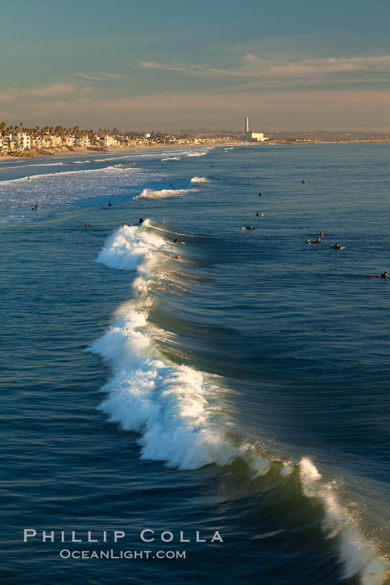 The coast of Oceanside California, waves and surfers, beach houses, just before sunset, winter, looking south. Oceanside Pier, USA, natural history stock photograph, photo id 27600