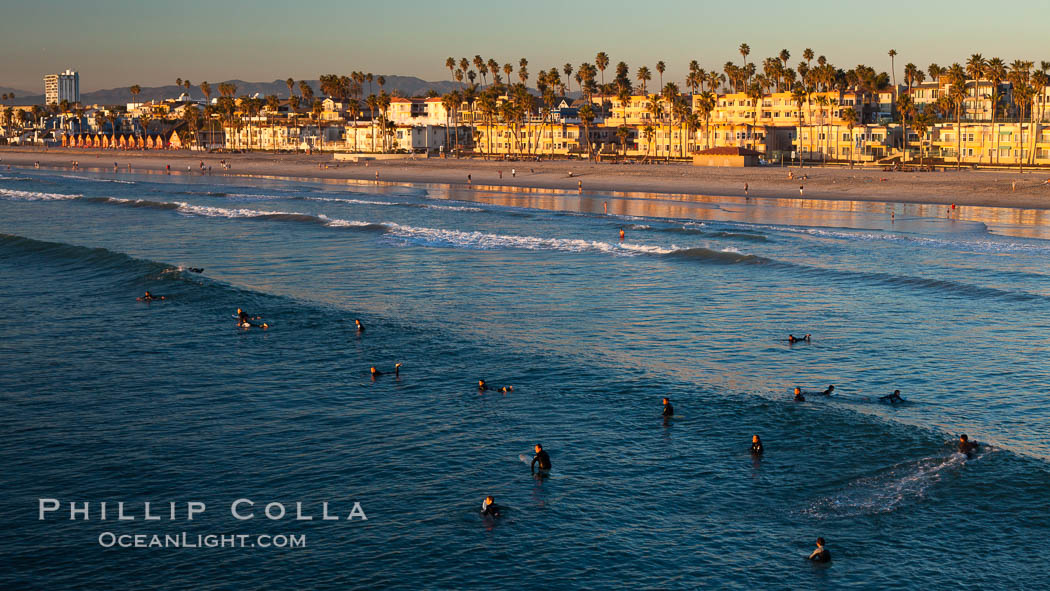 The coast of Oceanside California, waves and surfers, beach houses, just before sunset, winter, looking north. Oceanside Pier, USA, natural history stock photograph, photo id 27605