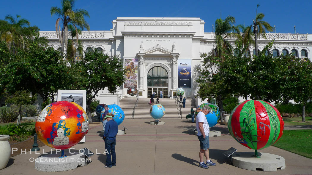 Cool Globes San Diego, an exhibit outside of the Natural History Museum at Balboa Park, San Diego.  Cool Globes is an educational exhibit that features 40 sculpted globes, each custom-designed by artists to showcase solutions to reduce global warming. Balboa Park, San Diego, California, USA, natural history stock photograph, photo id 21494