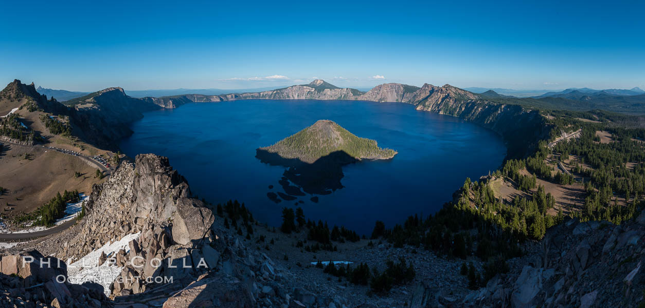 Panorama of Crater Lake from Watchman Lookout Station, panoramic picture. The Watchman Lookout Station No. 168 is one of two fire lookout towers in Crater Lake National Park in southern Oregon. For many years, National Park Service personnel used the lookout to watch for wildfires during the summer months. It is also a popular hiking destination because it offers an excellent view of Crater Lake and the surrounding area. Crater Lake National Park, Oregon, USA, natural history stock photograph, photo id 28632