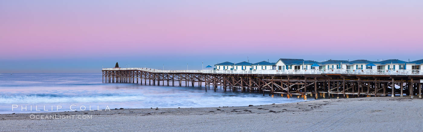 The Crystal Pier and Pacific Ocean at sunrise, dawn, waves blur as they crash upon the sand.  Crystal Pier, 872 feet long and built in 1925, extends out into the Pacific Ocean from the town of Pacific Beach. California, USA, natural history stock photograph, photo id 27244