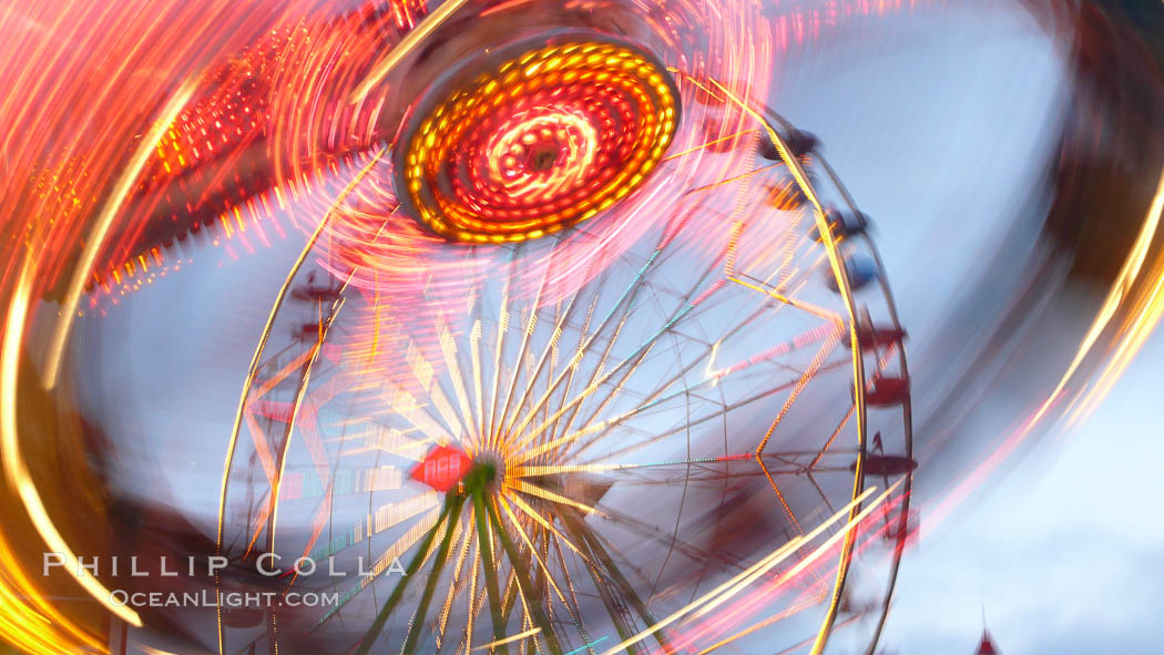Ferris wheel and fair rides at sunset, blurring due to long exposure. Del Mar Fair, Del Mar, California, USA, natural history stock photograph, photo id 20871