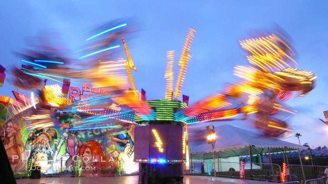 Image 20875, Del Mar Fair rides at night, blurring due to long exposure. Del Mar Fair, Del Mar, California, USA