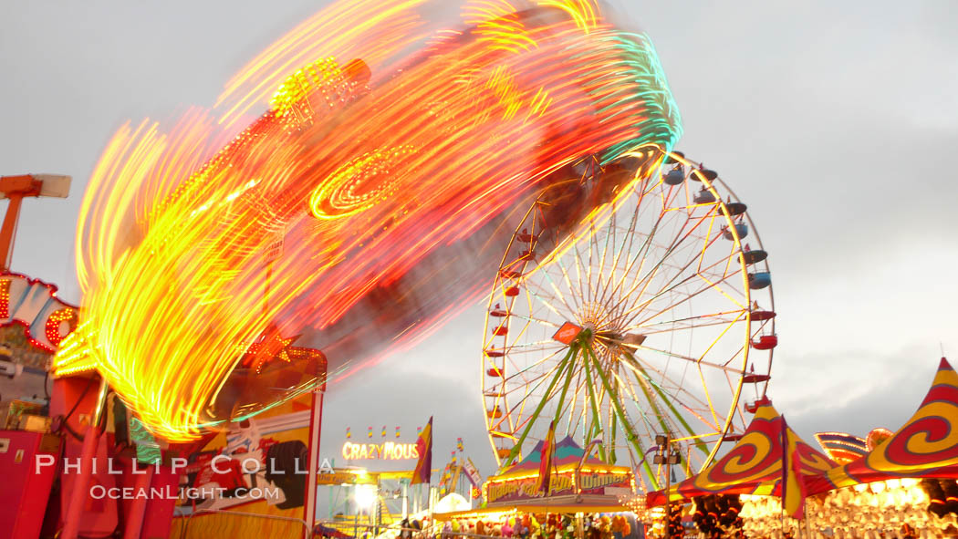 Ferris wheel and fair rides at sunset, blurring due to long exposure. Del Mar Fair, California, USA, natural history stock photograph, photo id 20873