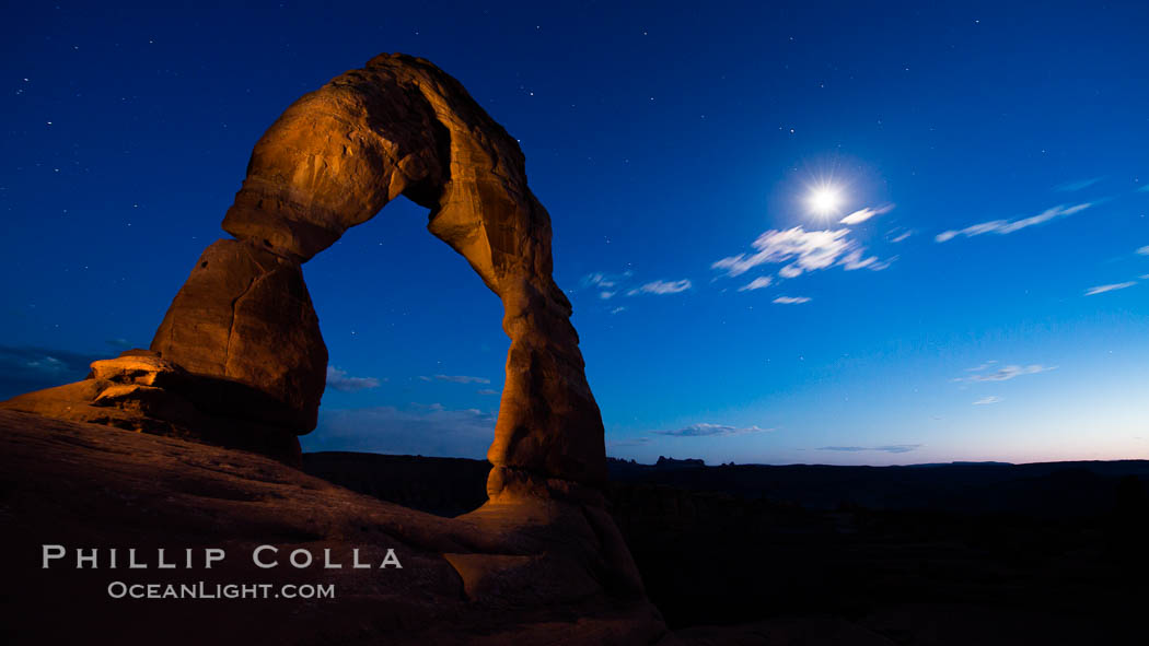 Delicate Arch and the Moon at Sunset.  The moon and clouds, with stars showing faintly in the sky, as sunset fades into night. Arches National Park, Utah, USA, natural history stock photograph, photo id 27860