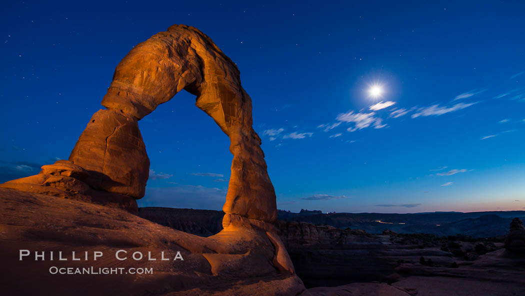 Delicate Arch and the Moon at Sunset.  The moon and clouds, with stars showing faintly in the sky, as sunset fades into night. Arches National Park, Utah, USA, natural history stock photograph, photo id 27859