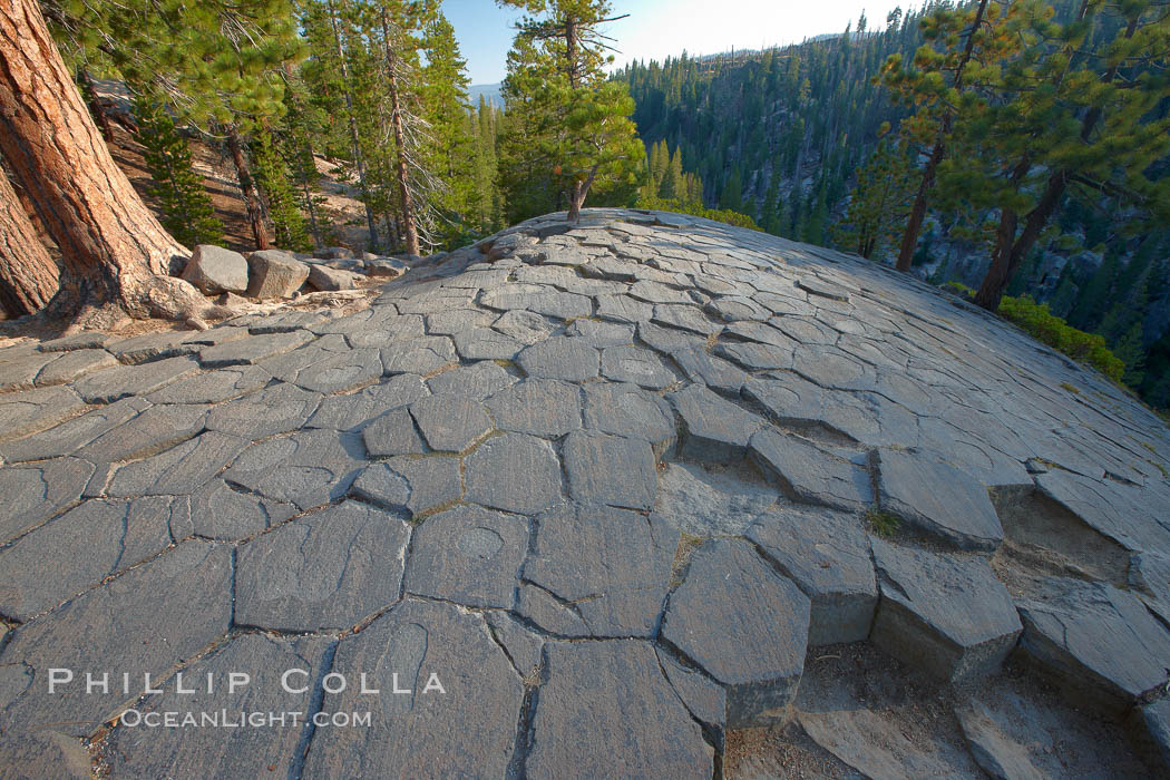 Devil's Postpile, a spectacular example of columnar basalt.  Once molten and under great pressure underground, the lava that makes up Devil's Postpile cooled evenly and slowly, contracting and fracturing into polygonal-sided columns.  The age of the formation is estimated between 100 and 700 thousand years old.  Sometime after the basalt columns formed, a glacier passed over the formation, cutting and polishing the tops of the columns.  The columns have from three to seven sides, varying because of differences in how quickly portions of the lava cooled. Devils Postpile National Monument, California, USA, natural history stock photograph, photo id 23287