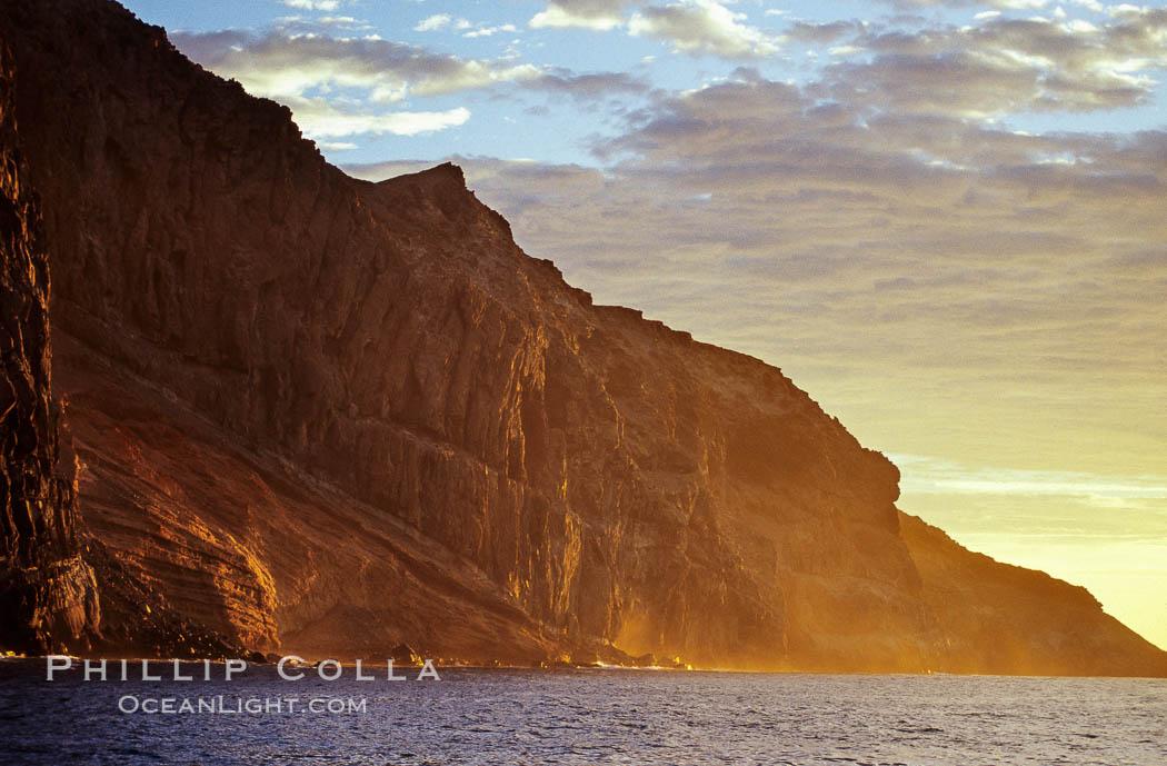 Image 06152, East face and shoreline of southernmost morro, daybreak. Guadalupe Island (Isla Guadalupe), Baja California, Mexico