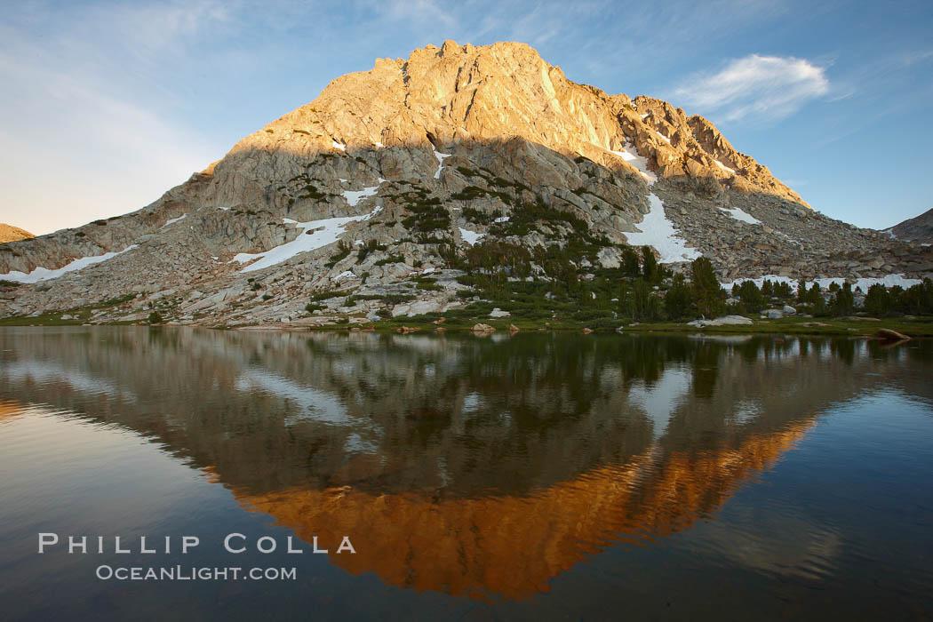 Image 23213, Fletcher Peak (11407') rises above Fletcher Lake (10174'), near Vogelsang High Sierra Camp in Yosemite's high country. Yosemite National Park, California, USA
