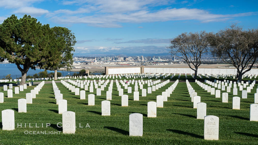 Tombstones at Fort Rosecrans National Cemetery, with downtown San Diego in the distance. California, USA, natural history stock photograph, photo id 30200