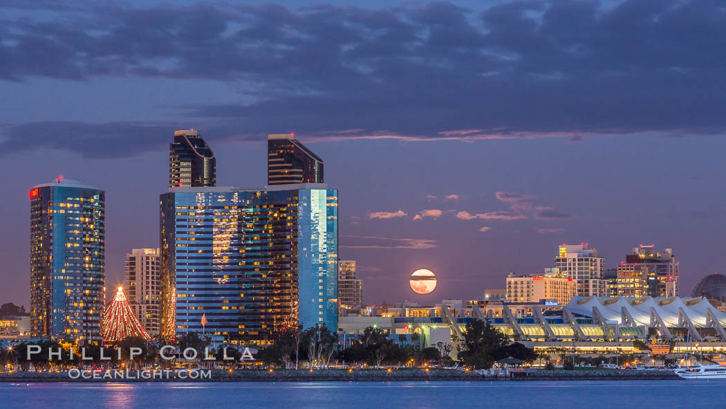 Full moon rising over San Diego city skyline, sunset, storm clouds, viewed from Coronado Island. California, USA, natural history stock photograph, photo id 28022