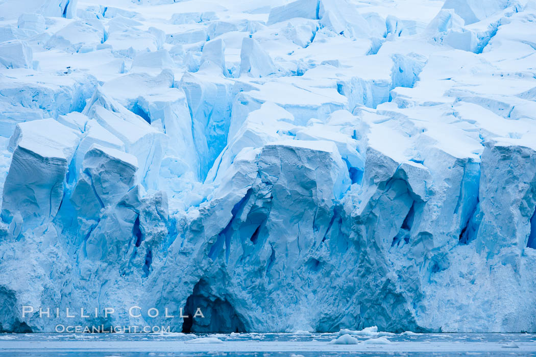 A glacier fractures and cracks, as the leading of a glacier fractures and cracks as it reaches the ocean.  The pieces will float away to become icebergs. Neko Harbor, Antarctic Peninsula, Antarctica, natural history stock photograph, photo id 25655