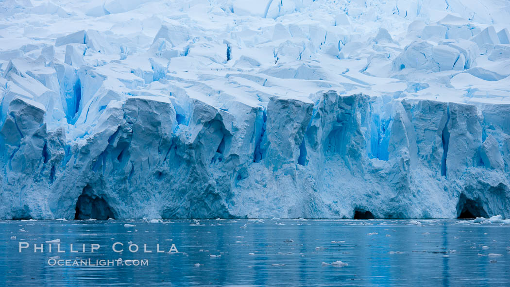 A glacier fractures and cracks, as the leading of a glacier fractures and cracks as it reaches the ocean.  The pieces will float away to become icebergs. Neko Harbor, Antarctic Peninsula, Antarctica, natural history stock photograph, photo id 25671
