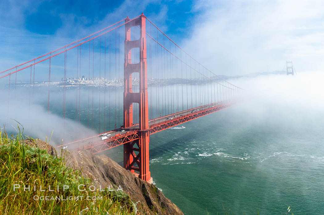 San Franciscos infamous summer fog overtakes the Golden Gate Bridge, viewed from the Marin Headlands with the city of San Francisco visible in the distance. California, USA, natural history stock photograph, photo id 09067