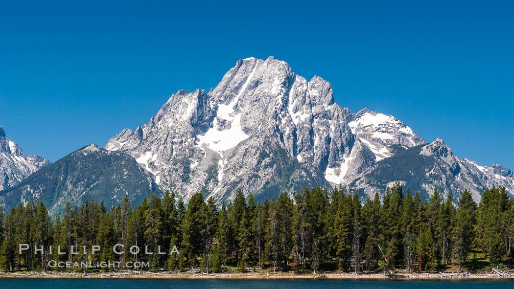 Mount Moran in the Teton Range rises above Jackson Lake, summer. Jackson Lake, Grand Teton National Park, Wyoming, USA, natural history stock photograph, photo id 07768